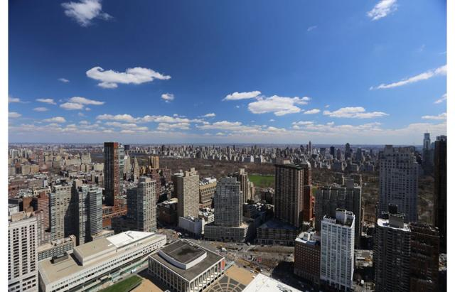 View of New York City and local apartment buildings on a partly cloudy afternoon.