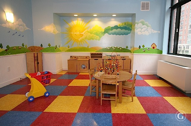 A colorful children's play room with red, yellow, and blue tiled floors.